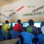 some of our participants learning digital skills at our learning center
